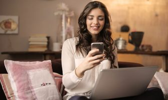 woman using mobile 335x200 - The Difference Between Casino Games in Mobile and Desktop